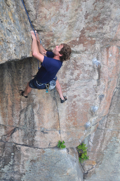Jeff Arliss contemplating the crux.