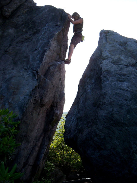 "Travis Melin taking it all in on the ""Highland Highball"" (v2) in the Highlands Area, GHSP, Va"