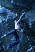 Rock Climbing Photo: jakob letting his feet swing free on the big jug.....