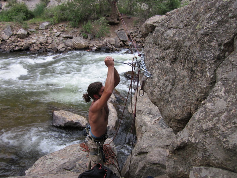 Darren tightening the line.  <br> Who needs warm up routes when you can do this!