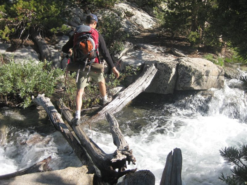 Jonny on one of the fun creek crossings on our way to upper Lamarck Lake.<br> <br> Taken July 13th, 2010.