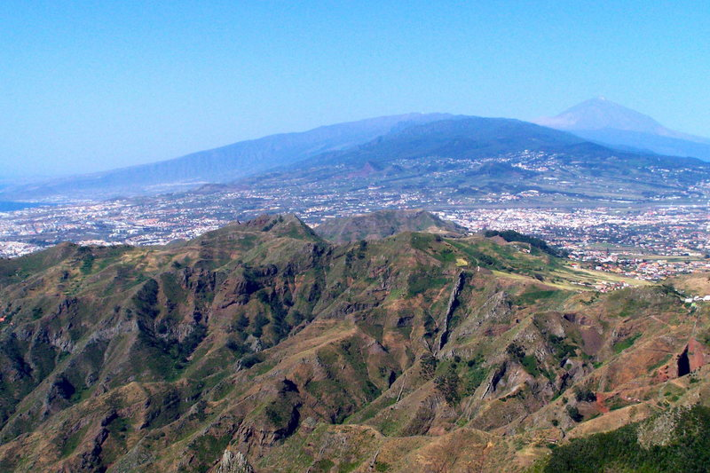 Looking south, down the length of the island.  The drier side is on the left.  The town in the center of the photo is La Laguna.  Mount Teide in the background.