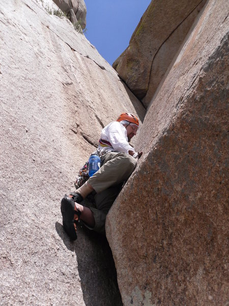 Clearing the first roof of pitch 3 (Karl's Korner).