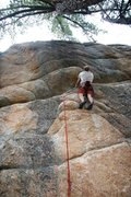 Rock Climbing Photo: Mike looking at the big move on Particle Accelerat...