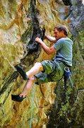 Rock Climbing Photo: Clinging to the cool, black tufa-like rail on the ...
