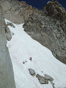 Rock Climbing Photo: Crossing the snow gully to reach the base.