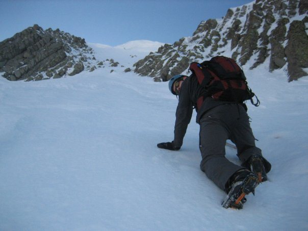 Climbing a steep couloir on Devils Peak.