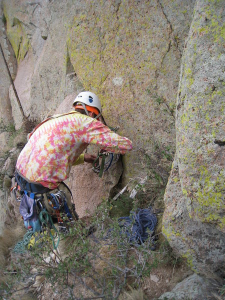 Aaron replacing webbing at the first rap anchor on the South Face Direct.