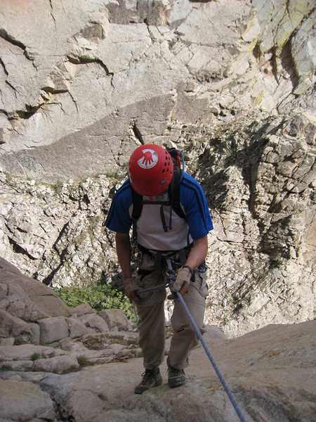 Myself heading down the second (double rope) rappel to the saddle between NRE and MRE via the South Face Direct.