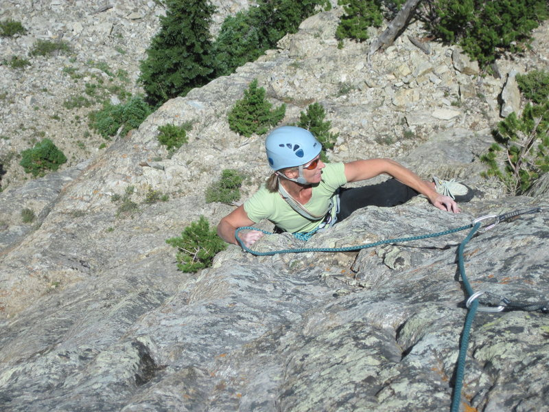 Becky Hall turning the &quot;Gunks-like roof&quot; on the headwall.<br> <br> (Photo: Charley Mace.)