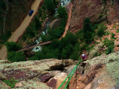 Lynette rappelling down from the wind tower in Eldorado Canyon, CO.
