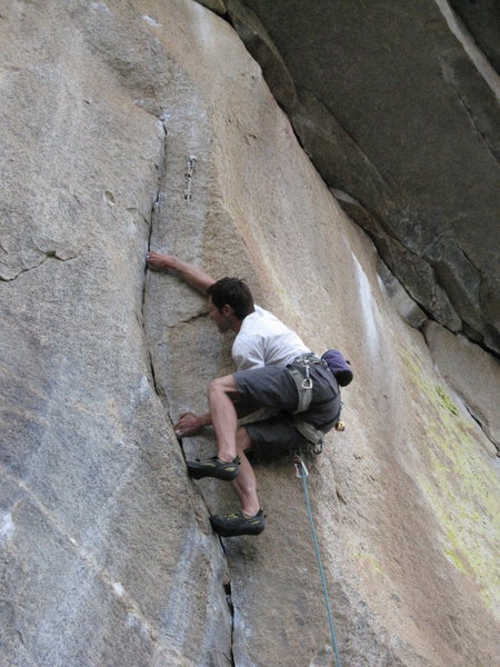 S. Giffin climbs through liebacks and fingerlocks on the initial portion of Atmosphere (12c) on Aerie Dome.