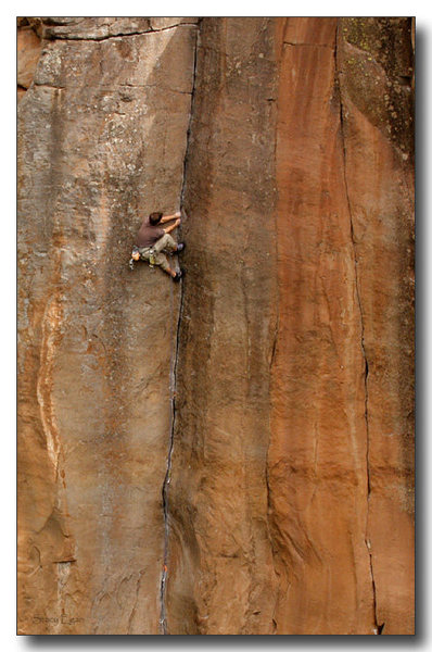 Scotty works the layback over the second cruxy bulge on the flirtatious and classic Paradise Lost 5.12-, Paradise Forks.