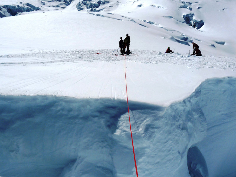 """My look across the """"practice crevasse"""" - I punched through the left side of this crevasse about 30 minutes later on a snow bridge that other people walked over unroped -- happy for my rope team, Dima and John"""