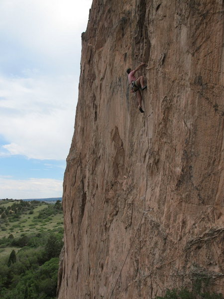 Climber works the first crux of Skyline Pig.
