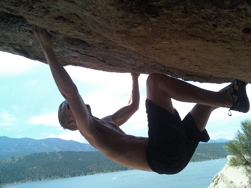 Going from a jug in the roof to a bad right hand pinch with a shallow two finger pocket. Crux.