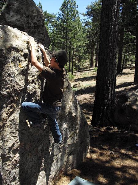 Rock Climbing Photo: Mitchell Boring on Consumer Gluttony V0, Pine Mtn ...