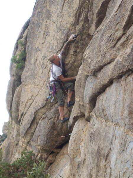 Climbing the beginning moves of Airgasm-5.10