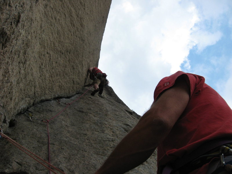The upper dihedral.  Shortly (seconds) after this photo was taken, the cloud above dumped torrential rain, making the casual 5.9 layback somewhat more difficult