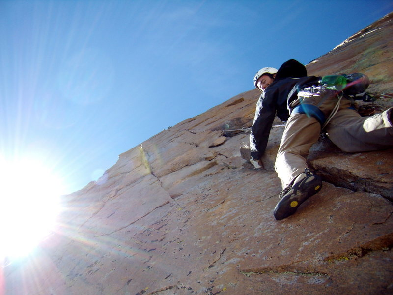 Climber following the crux pitch of Pervertical Sanctuary. August 7th 2010.