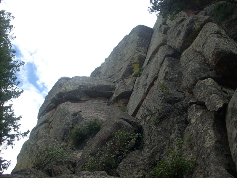Slab Route, Right goes past the small roof to the right and into the right-facing dihedral.