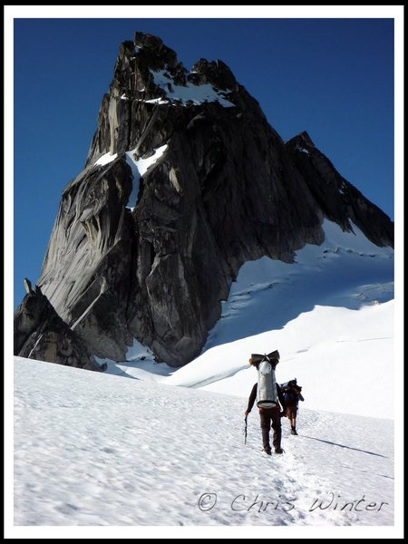 Climbers En Route to the East Creek Bivy with Pigeon Spire in the Background