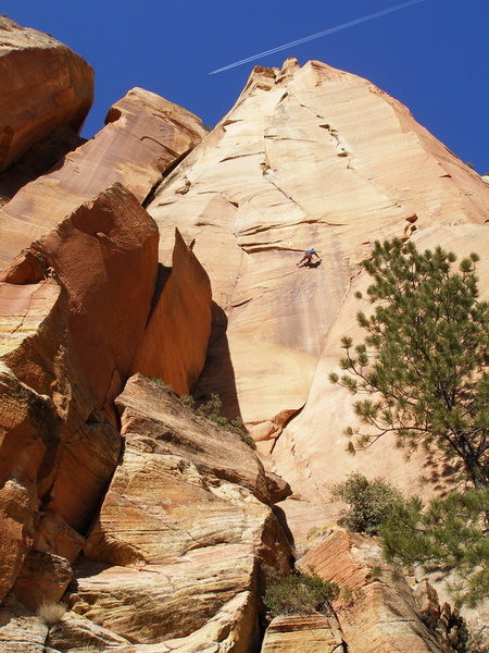 Adam pendulums from the pitch 10 anchors to reach the start of the aid pitch