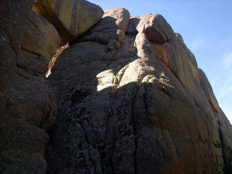 Stay right of the large boulder with the yellow streaks.  If you climb the crack between the boulder and the face (like I did), it feels harder than Outer Notch.