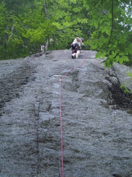 Jeff Lea contemplates the crux finish on AP Treat, Cathedral Ledge, North Conway. Phot by Chad Hussey
