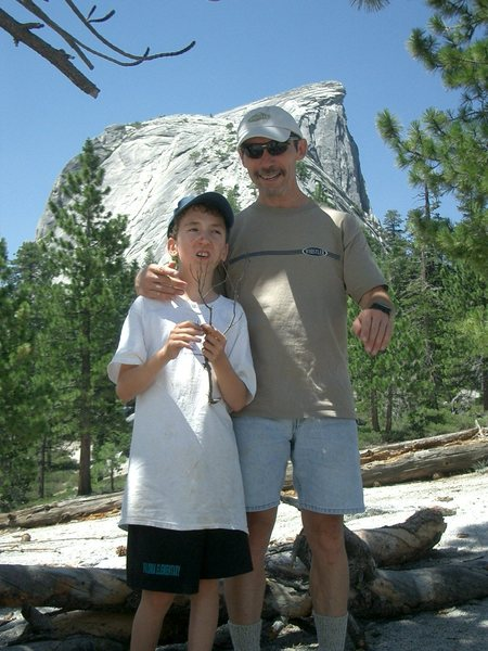 Me and my boy at the base of Half Dome after chickening out the first time in 2006.  Made it half way up the cables in 2010 before turning around.  2011 we WILL make it to the top!