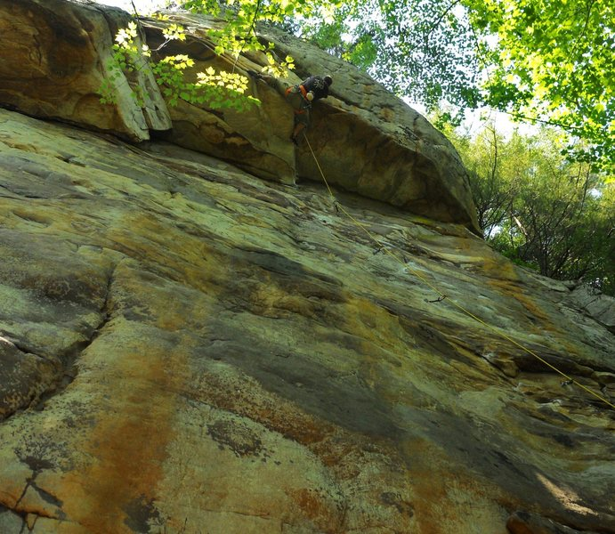 "Pulling the relaxed roof of ""Satisfaction Guaranteed"" 5.11a NRG, WV"