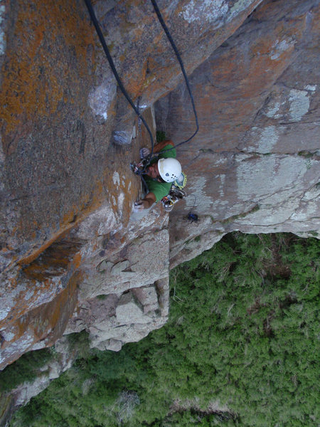 MattL cruxing at the top bolt on the second pitch.