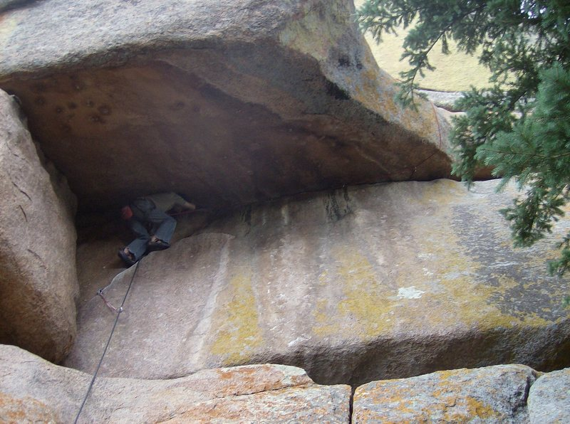 Pitch 1: traverse under the roof and around to the ledge.