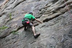 Vardan pulling an undercling halfway up Cumberland Blues