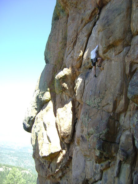 Scotty firing through the 12a crux on the lower portion.