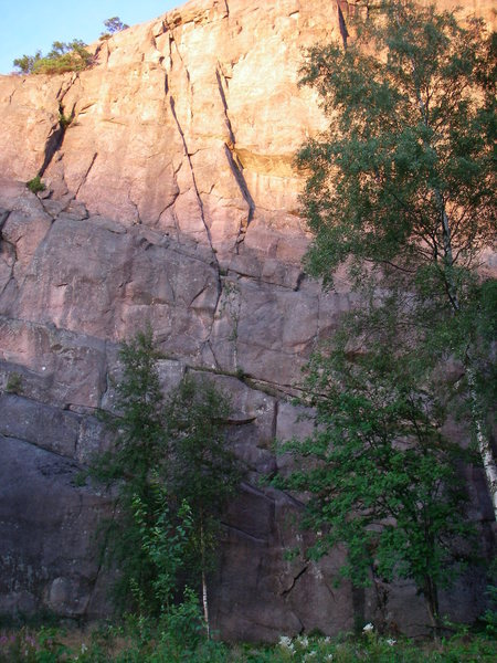 Rock Climbing Photo: The route starts on the flakes, visible on the fac...