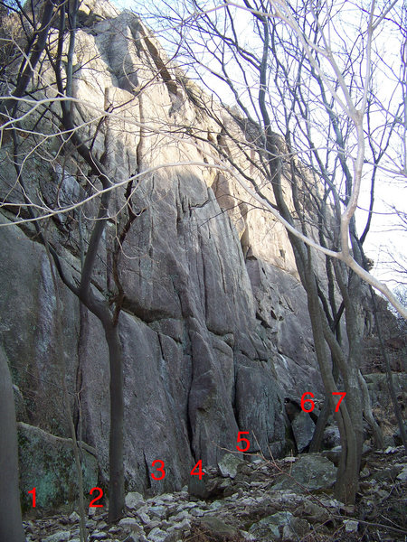 L-R, the first 7 routes on the N face.