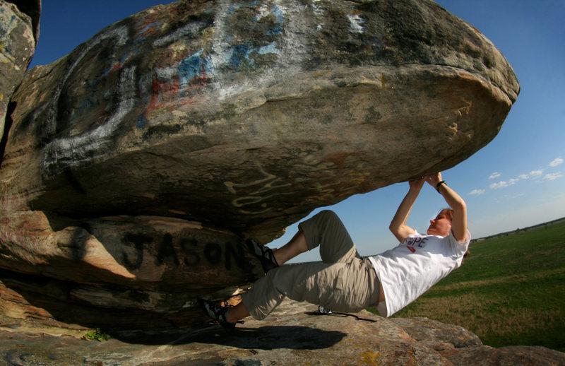 "Arel climbing ""Butt Cheeks"" to the right of ""Bert"" v-0 Photo: Cody Brundidge"