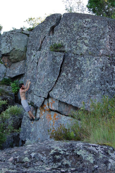 Project Boulder on the back of little Presque.  15 foot tall big fists to off width crack line and a huggy arete line.  Super flat landing.  Go get it!