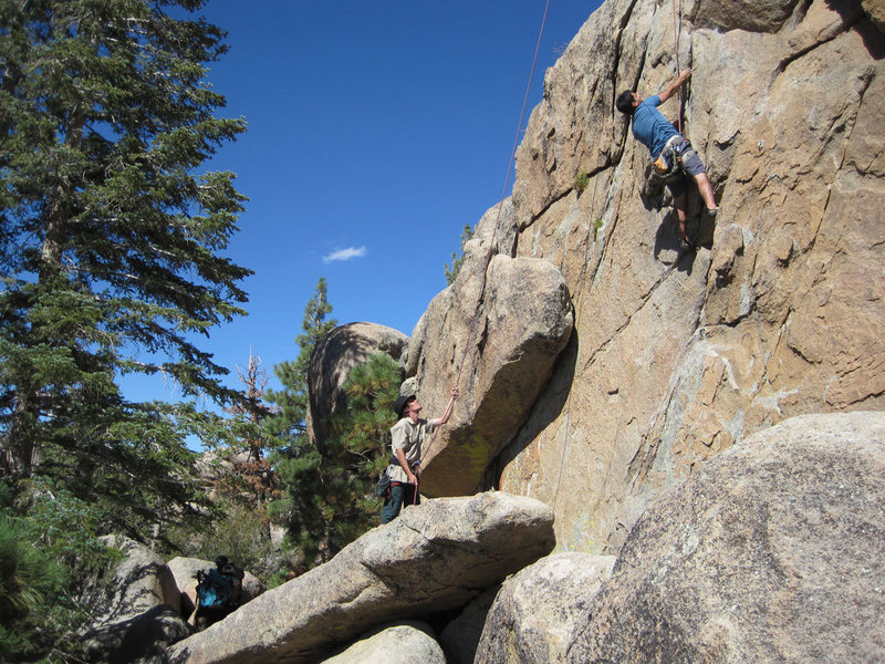 Lluis climbs while Christian belays - crux moves.