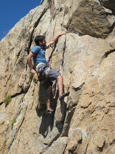 Lluis chalks up just past the crux.