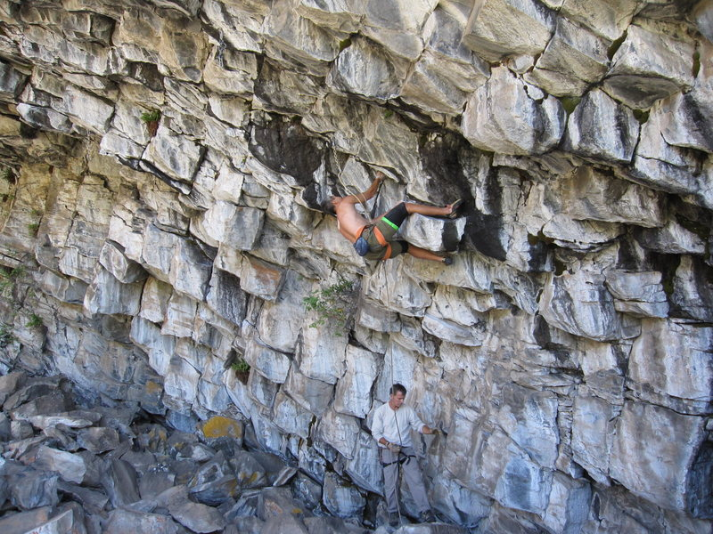"""'Hey Ladies' (13b) climbs horizontally on the underside of the cave. The sequence on this route is as follows: (1) Place knee bar/scum@SEMICOLON@ (2) move one hand@SEMICOLON@ (3) move knee to different knee scum@SEMICOLON@ (4) repeat. Incidentally, the """"consensus"""" on this route is 12d/13a@SEMICOLON@ funny, because its WAY harder than 'Cell Block' (13a) at Jailhouse....gotta love the choss crawling sandbag crew."""