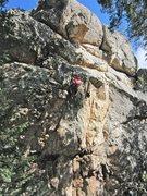 Rock Climbing Photo: Climber nearing the top of the climb.