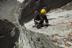 Rock Climbing Photo: Drilling the lone bolt on P3 during the FA.  Photo...