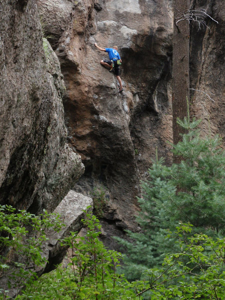 Kenton making the thin crux moves onto the slab.