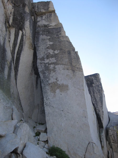 Razor back climbs the tall block.  Starts on left arete and finishes on right arete.