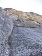 Rock Climbing Photo: Heading up the 3rd Pitch corner - 5.8
