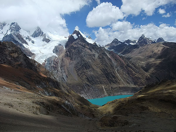 Cordillera Huayhuash (Peru): first glimpse of Solteracocha Lake and the massive glacier below Mituraju (18,864 ft), Jirishanca (19,993 ft), and Yerupaja Chico (19,977 ft)