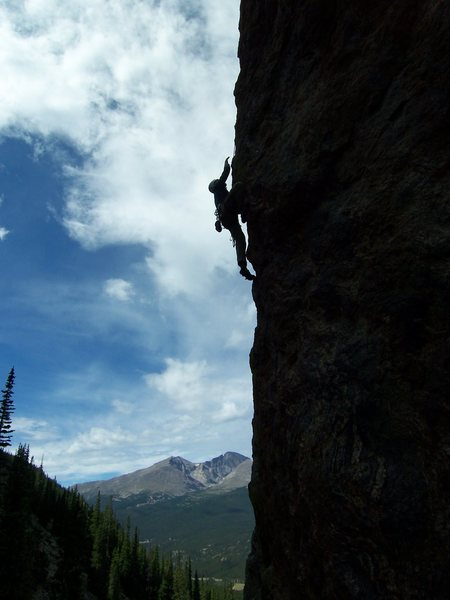 Joe is working through the crux arete moves.