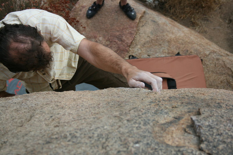 Nathan on the hardest problem on this boulder.